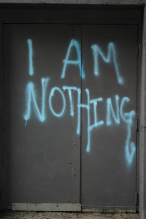 """i am nothing"" in blue spraypaint"